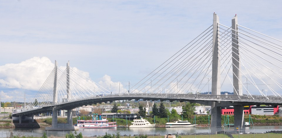 Tilikum Crossing, which will allow buses, bikes, walkers, and light rail but not private cars, will open in September 2015.
